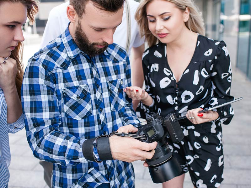 a group of photographers working together