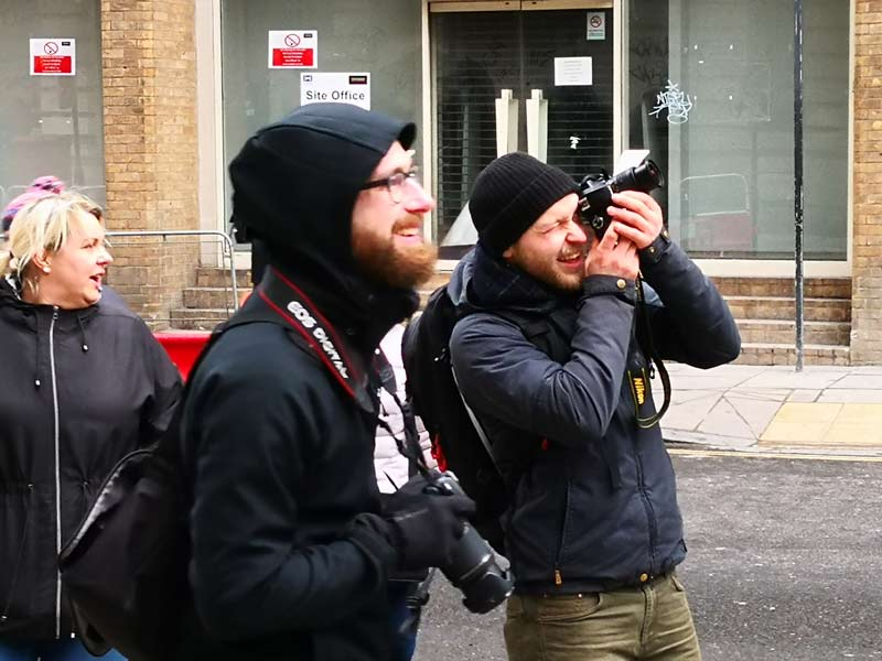 a group of photographers on a street photography tour