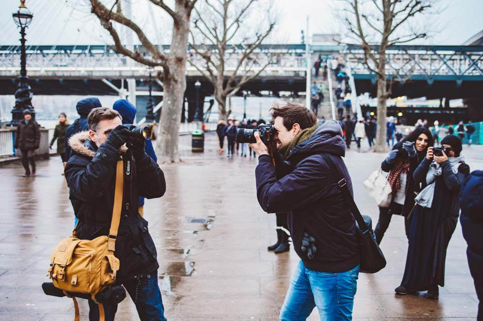 two photographers taking photos of each other in London