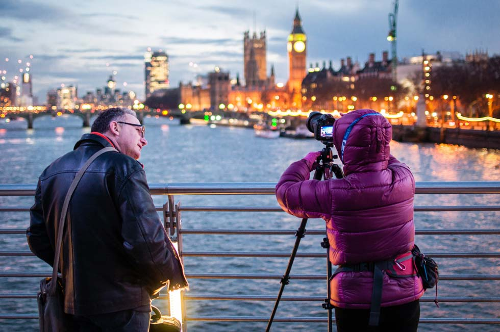 two photographers on a London bridge