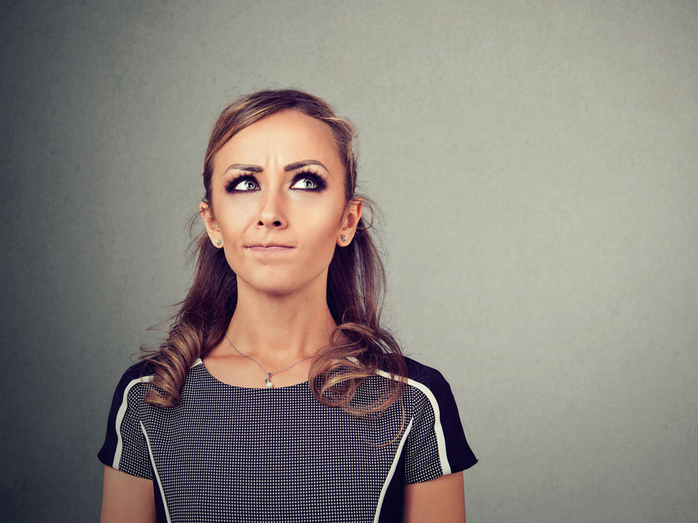 woman looking unsure about a decision